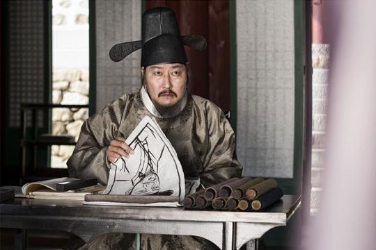 Song Kang Ho dans le rôle de NaeKyung, le meilleur liseur de visage du Joseon